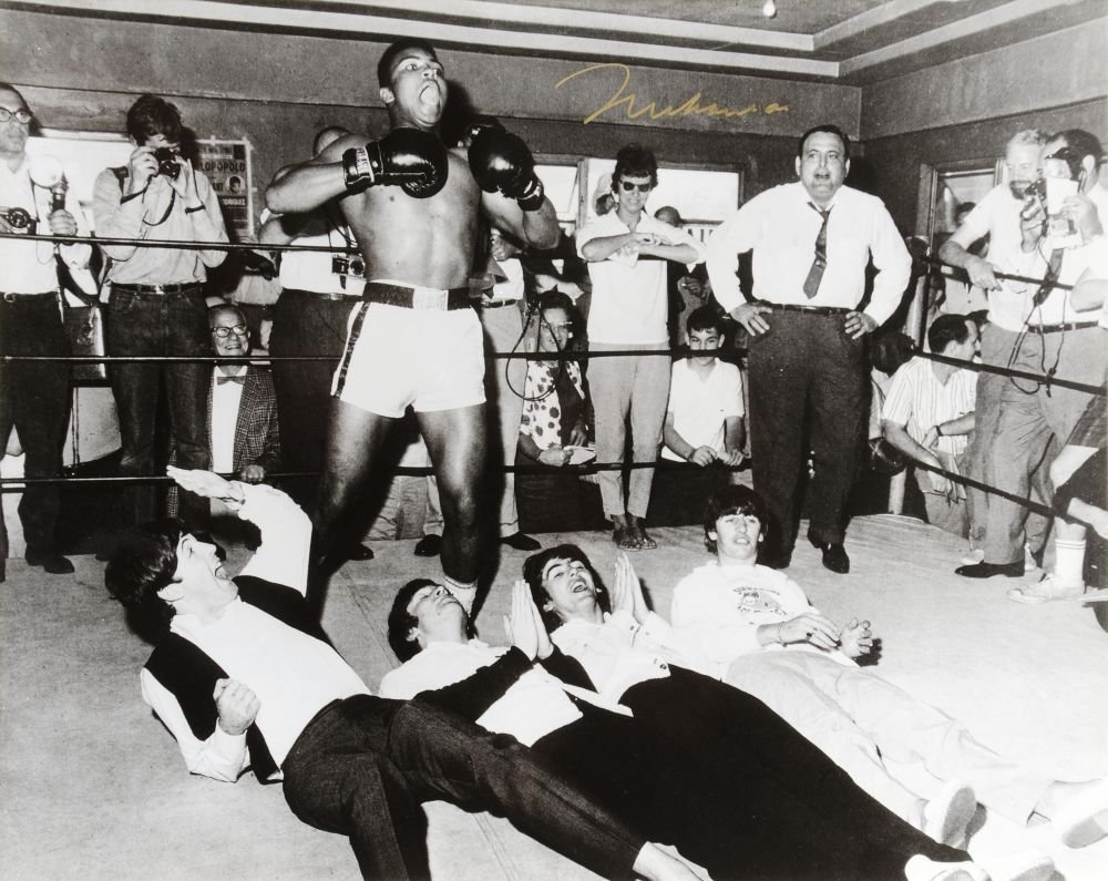 MUHAMMAD ALI & THE BEATLES, photograph of Ali standing