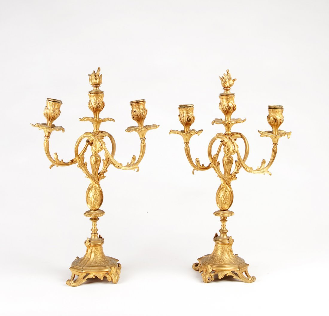 A pair of gilt bronze three branch candelabras, French