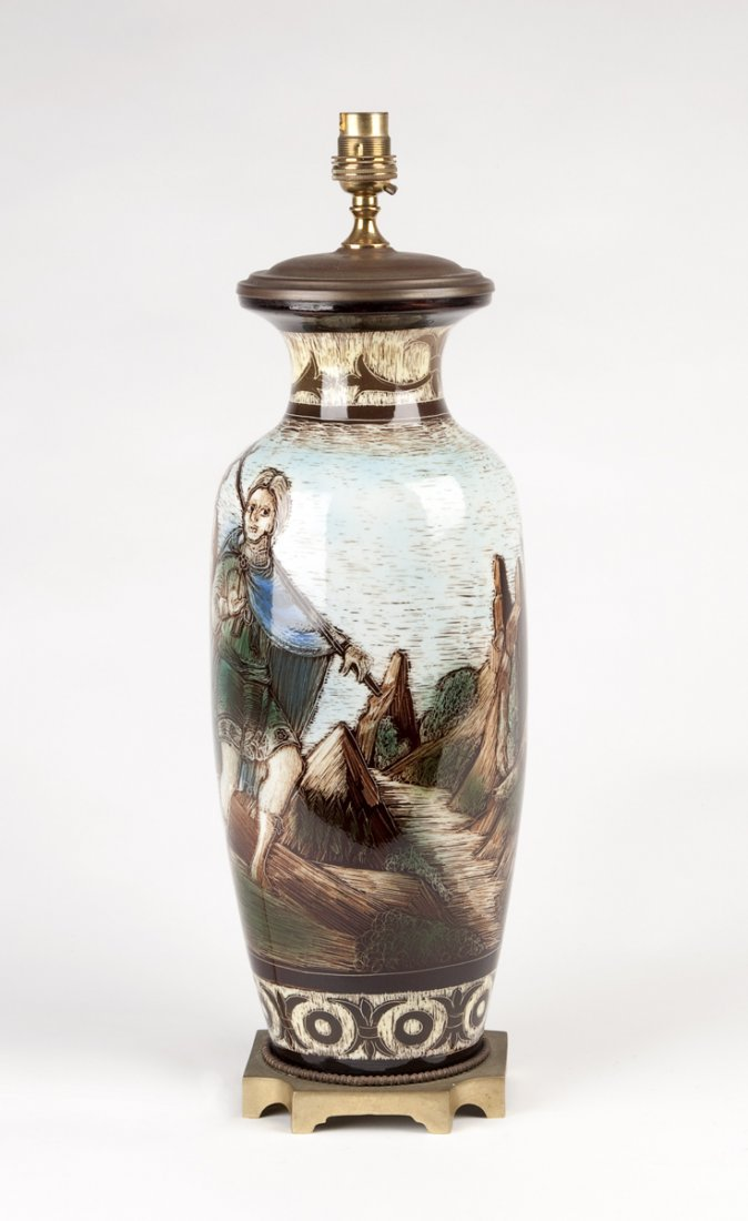 An unusual sgraffito ceramic oil lamp with gilt metal