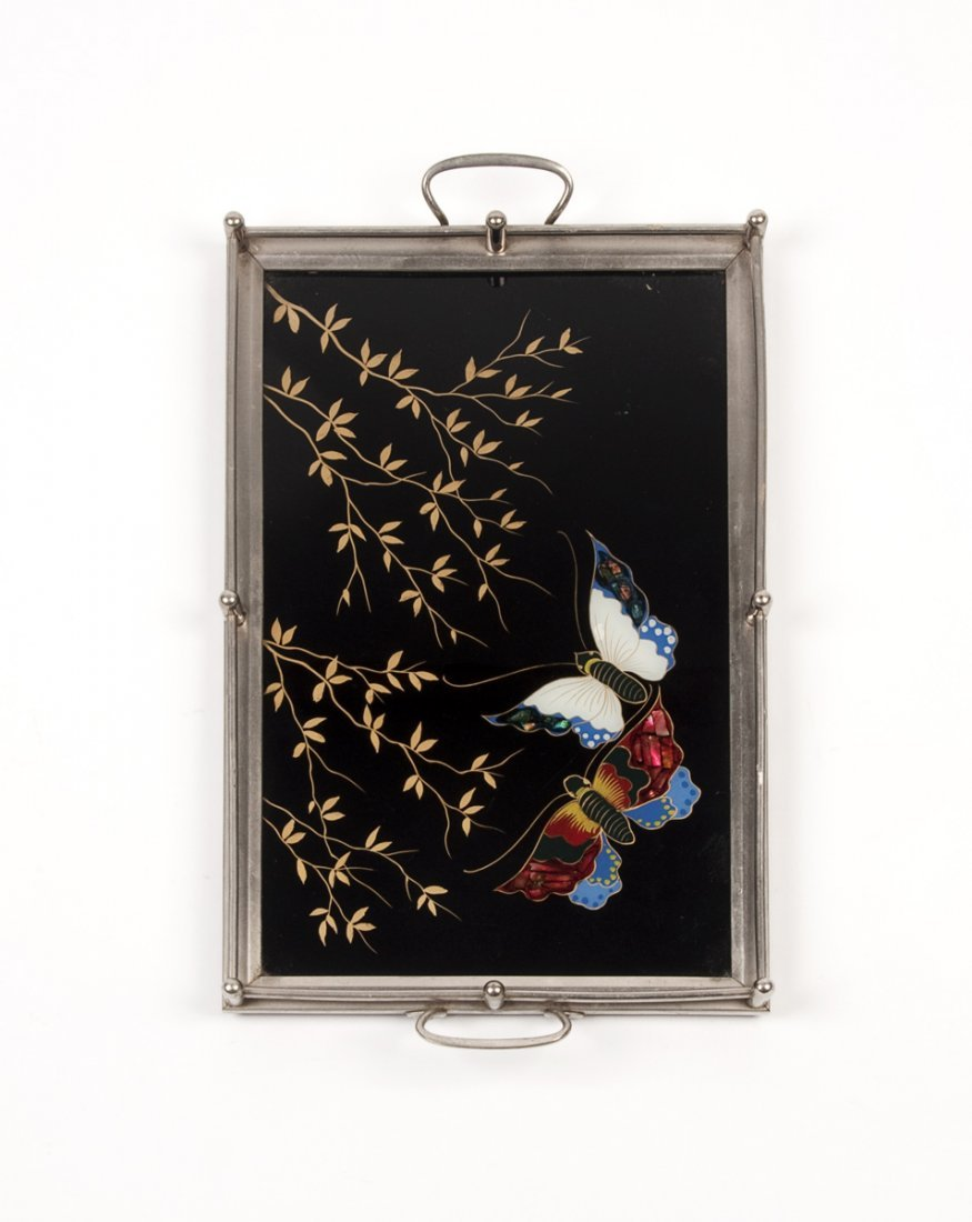 A reverse decorated glass and metal mounted butterfly