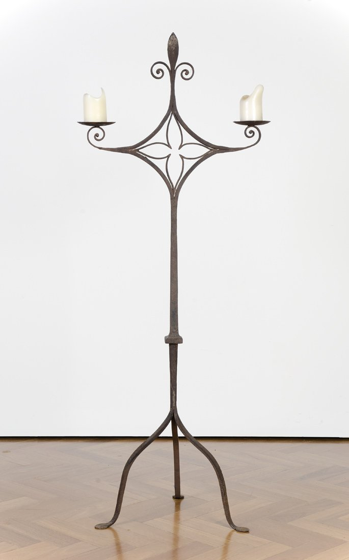 A Spanish wrought iron twin branch candle stand,