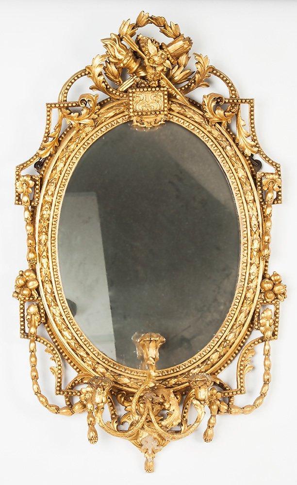 A gilt gesso oval girandole mirror, English in the