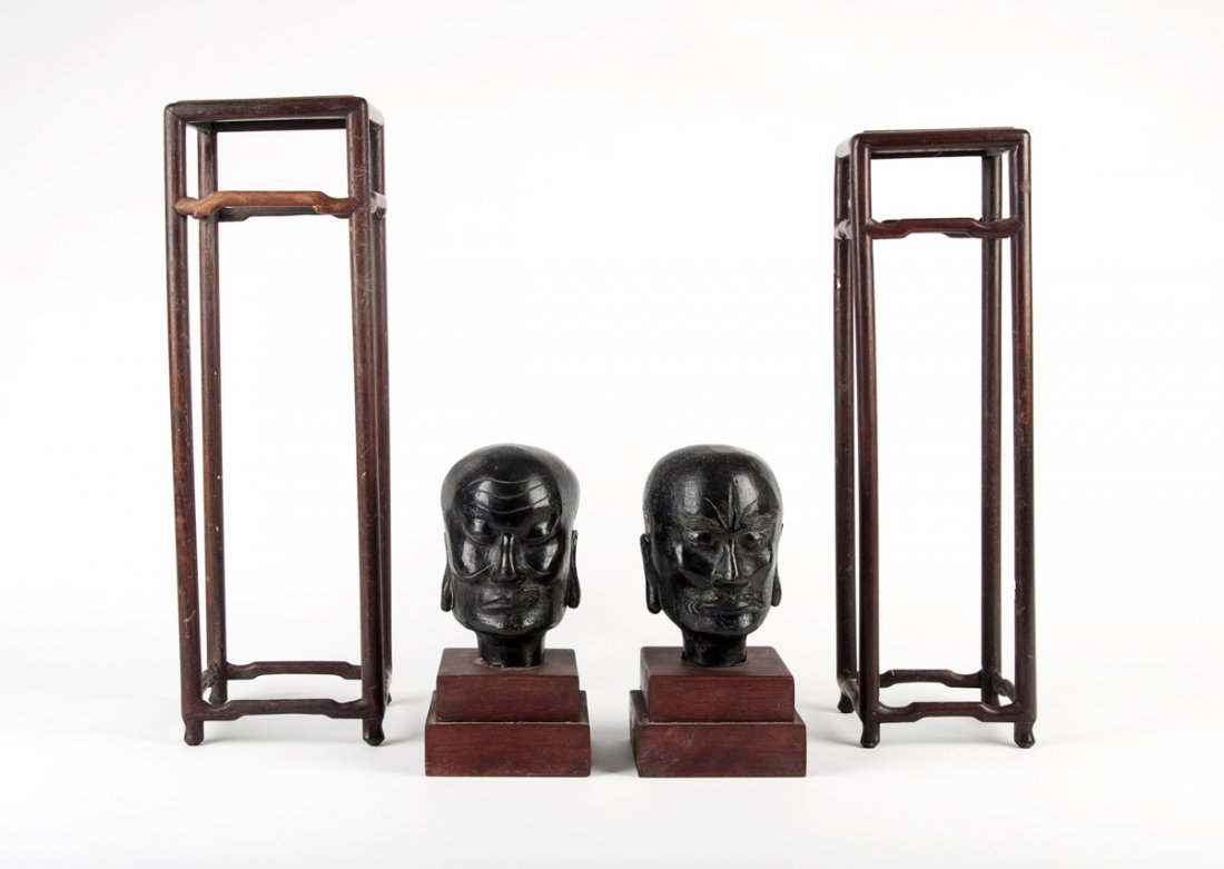 Two Chinese hardwood square vase stands, 38 and 41cm