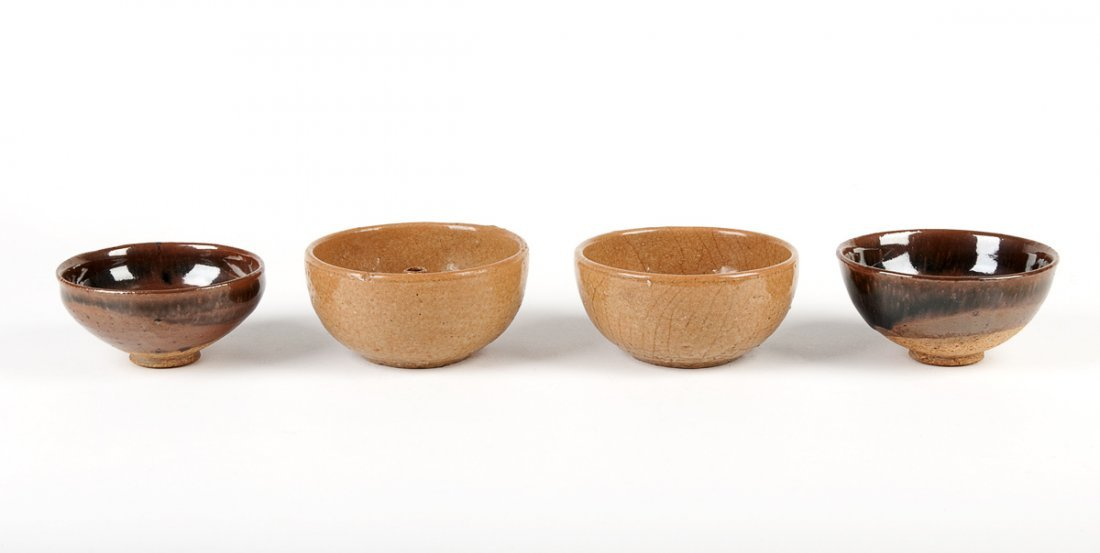 A pair of red stoneware incense bowls, covered in a