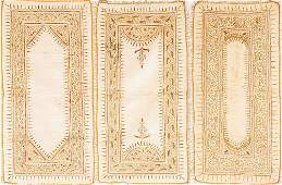 A set of three cream silk and gold thread embroidered