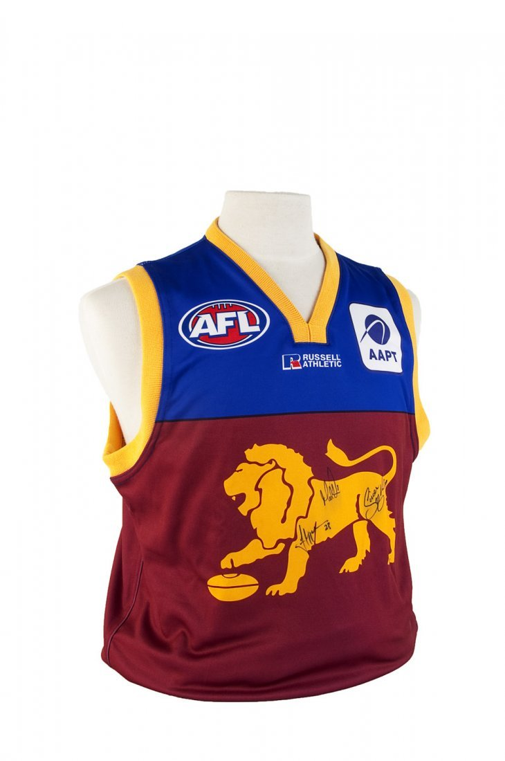 SIGNED ITEMS: Brisbane Lions jumper with 3 signatures