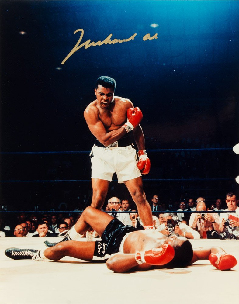 MUHAMMAD ALI, signed colour photo of Ali standing over