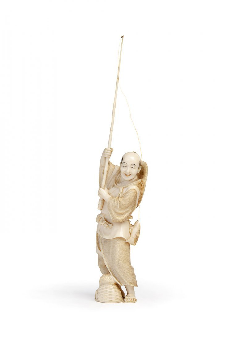 A Japanese ivory Okimono  of a fisherman, Meiji Period