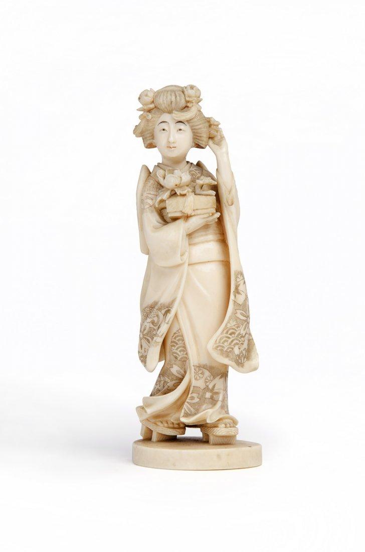 A Japanese ivory Okimono figure of a geisha, Meiji
