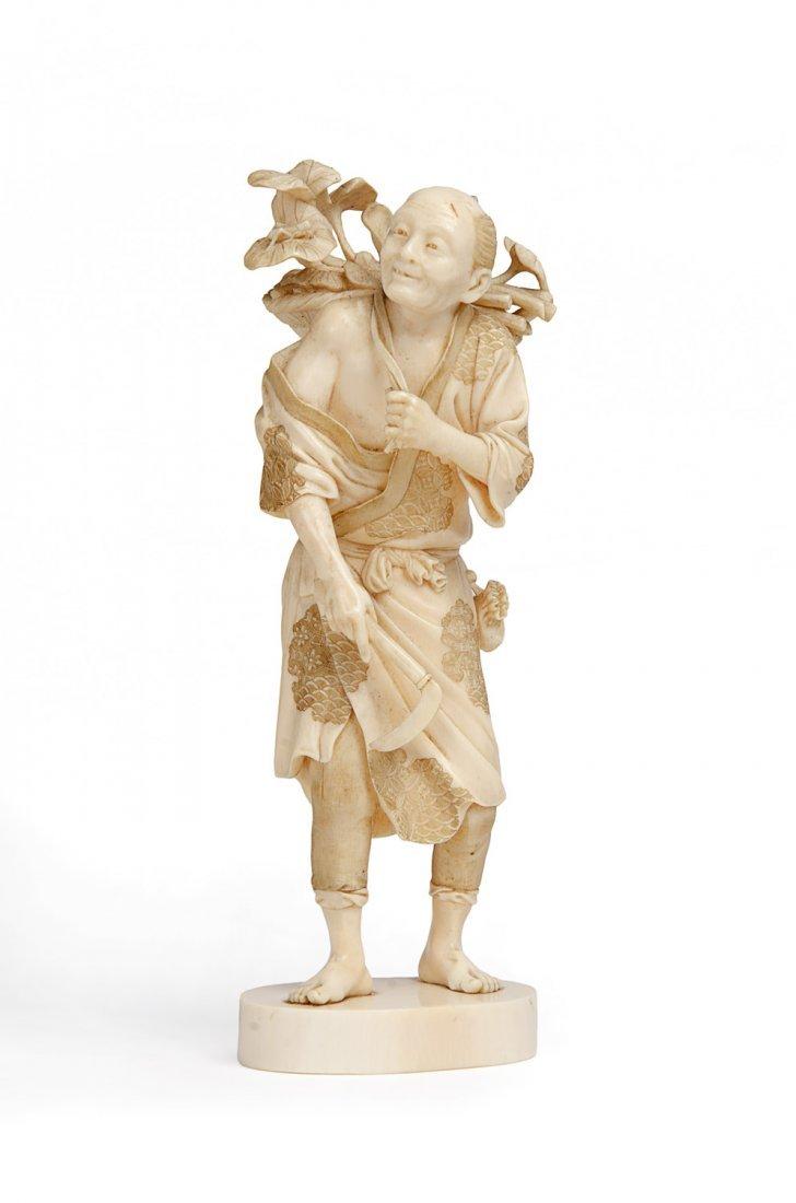 A Japanese ivory Okimono of  a man, Meiji Period