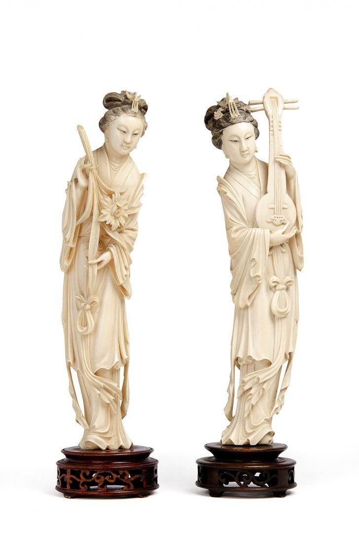 A pair of Chinese ivory figures of female immortals,