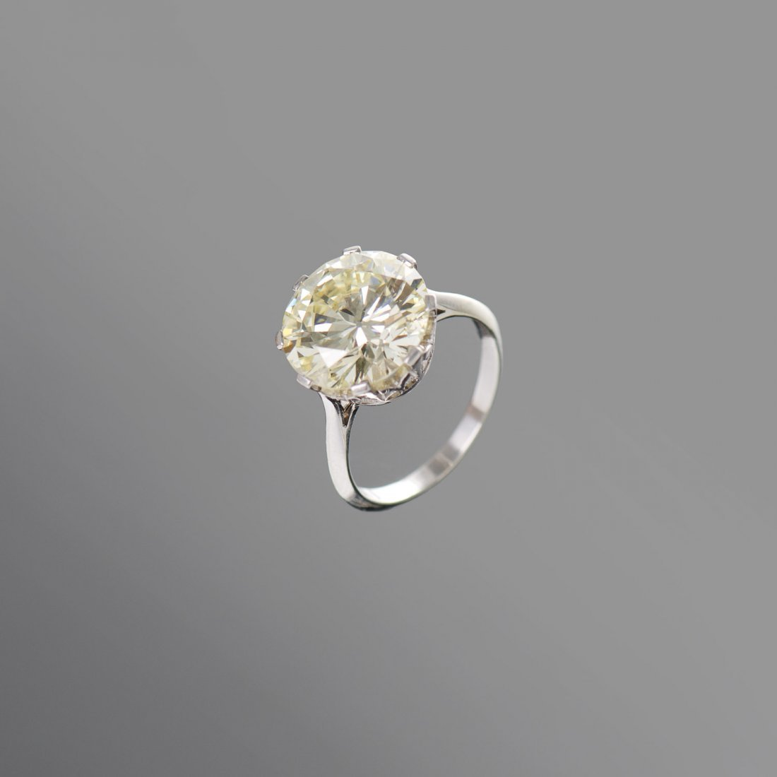 A 6.81 carat solitaire diamond ring Eight claw set with