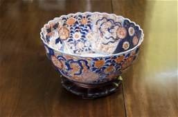 A large Japanese Imari fluted circular punch bowl,