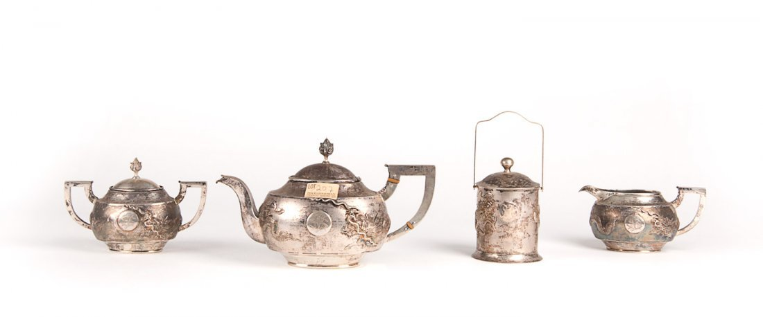 A Chinese three piece silver tea set, early 20th