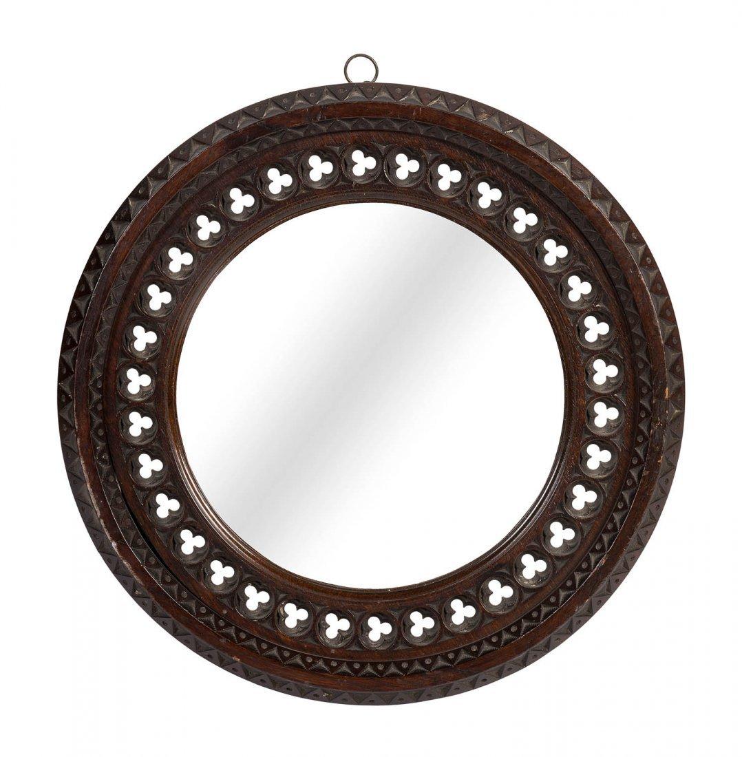 An unusual gothic revival circular convex wall mirror,