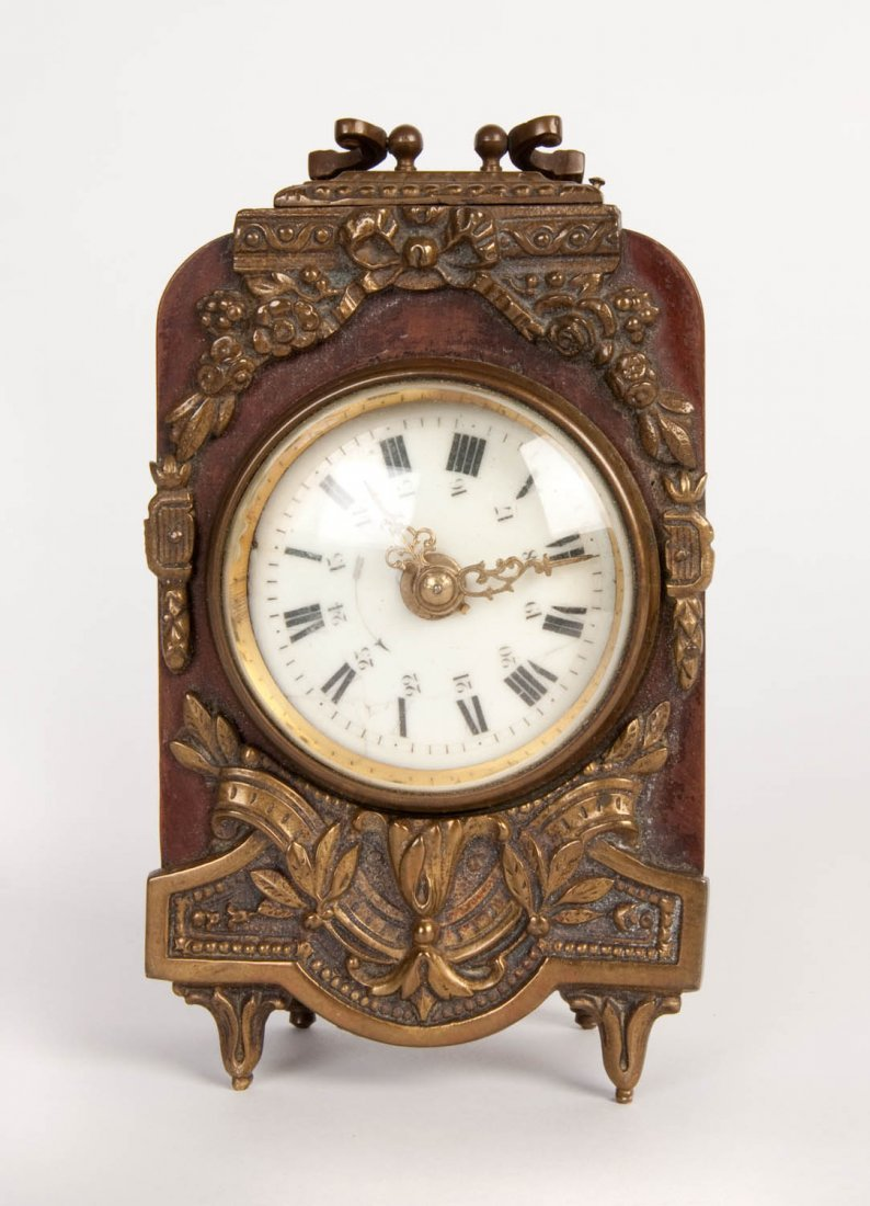 A small bronze mounted and enamel time-piece, French,