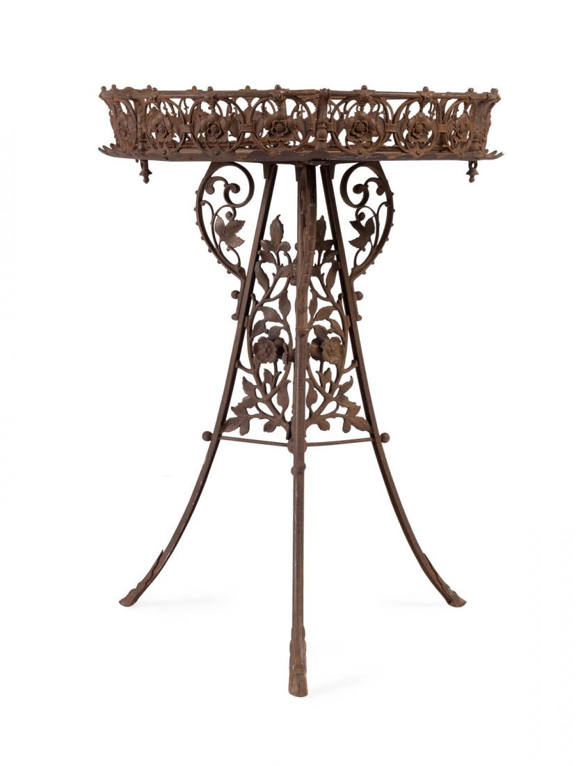 A fine cast iron jardiniere stand in the Gothic Revival