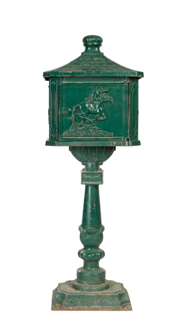 A bottle green painted cast iron letterbox on pedestal,