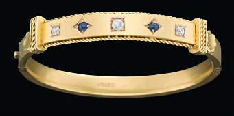 A gold, sapphire and diamond bangle by Flavelle,