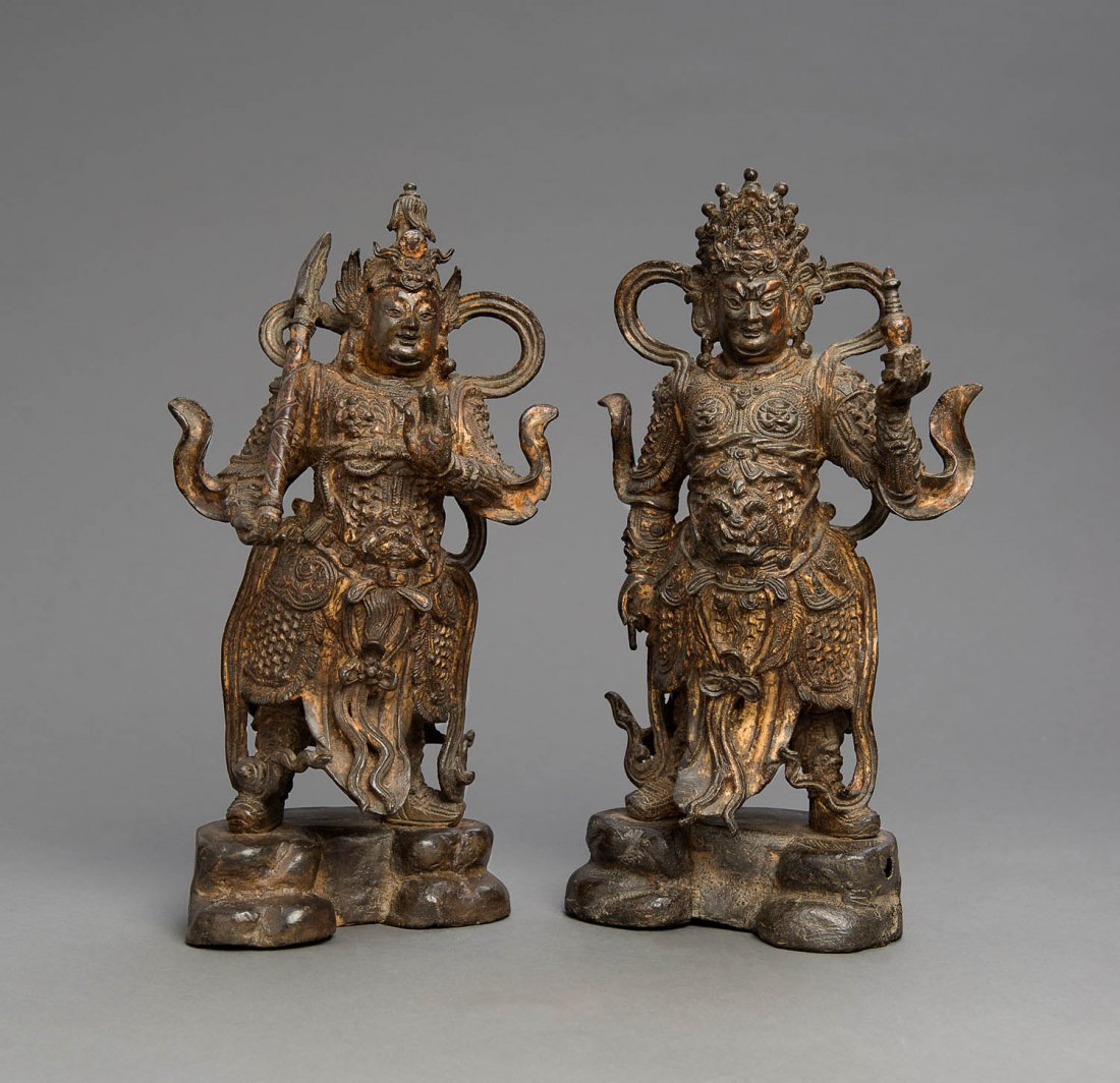 A pair of Chinese gilt and polychrome bronze Buddhist
