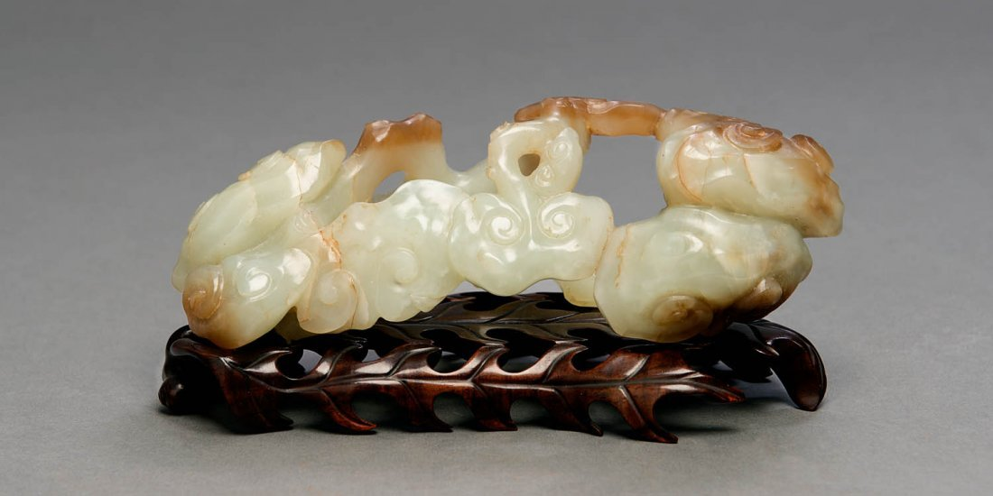 A rare pale celadon jade brush-rest, Qing Dynasty, 18th