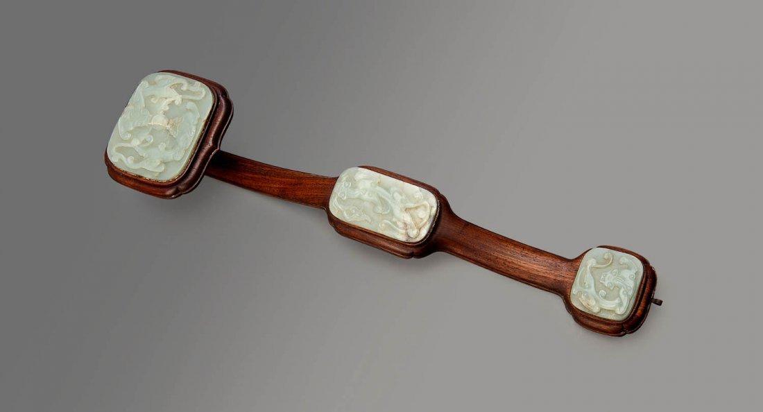 A hardwood ruyi sceptre, Qing Dynasty, 19th century