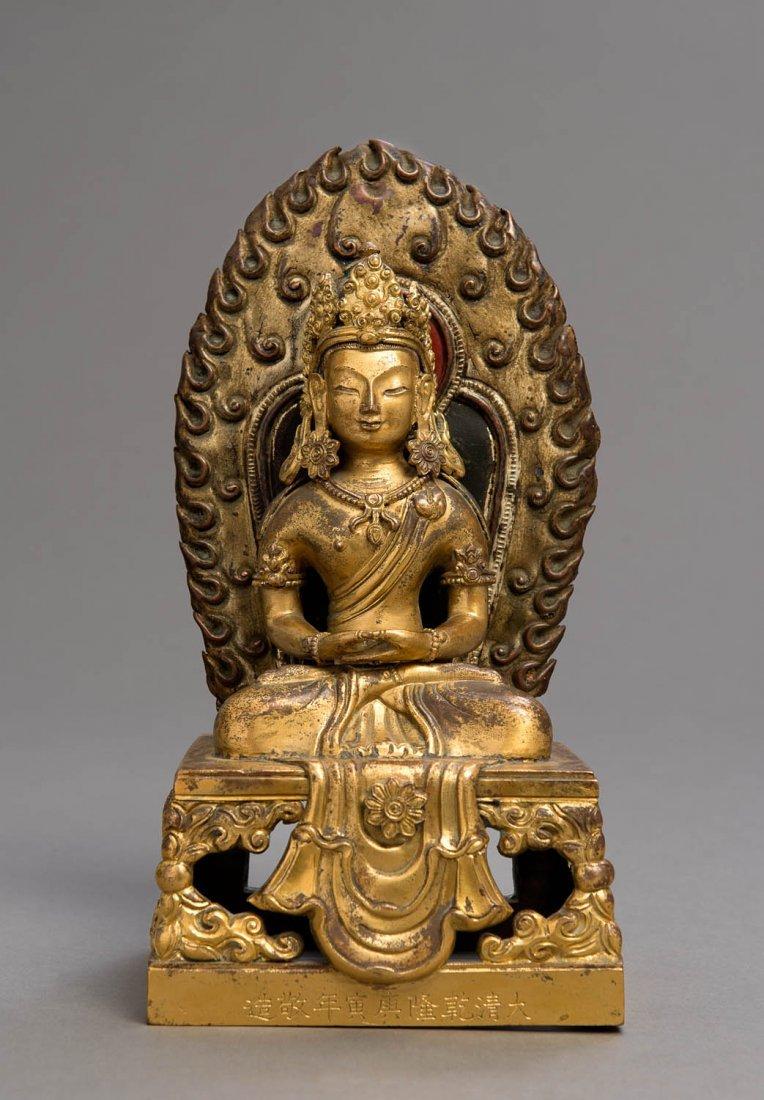 A cast gilt-bronze figure of Amatayus, nine character