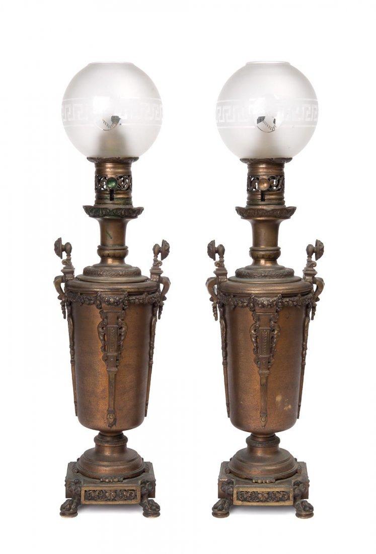 A pair of gilt bronze, brass and copper moderator