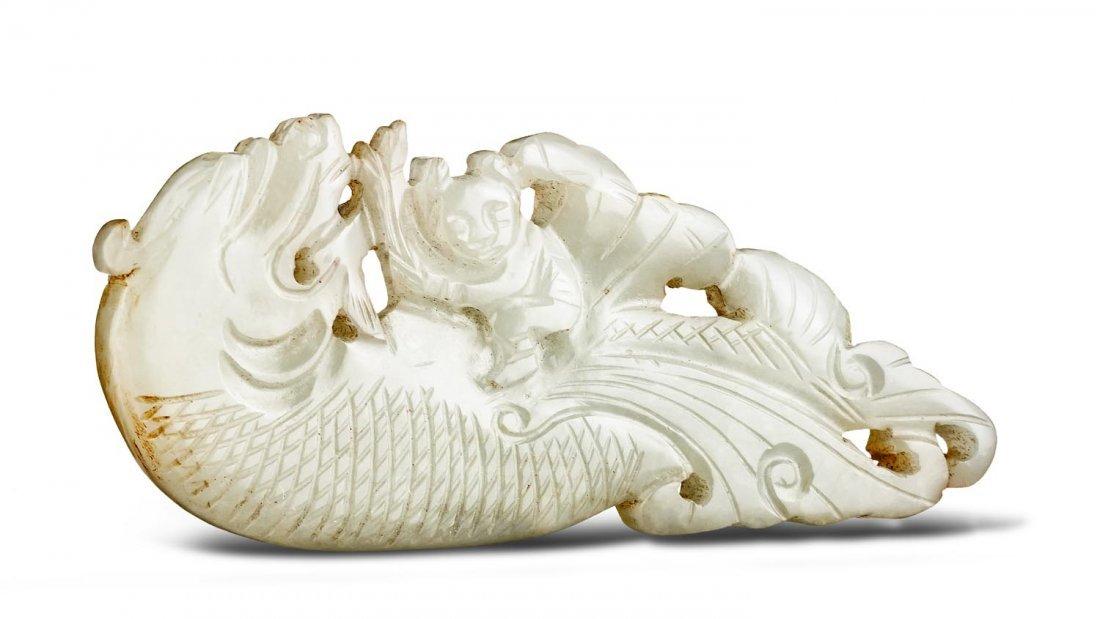 A white jade dragon pendant, 19th Century