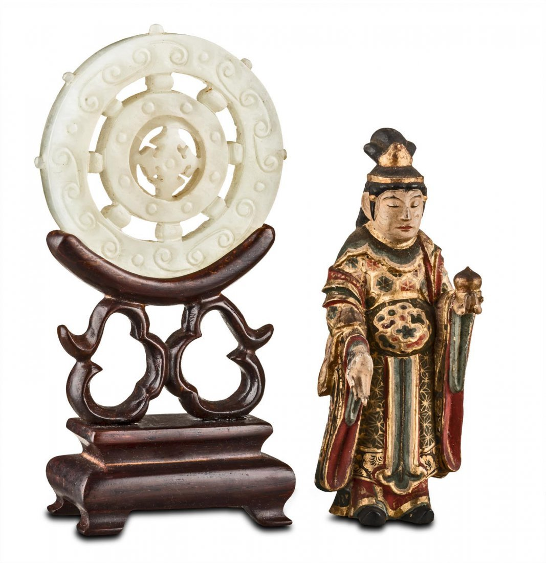 A white jade circular disk, late Qing dynasty –