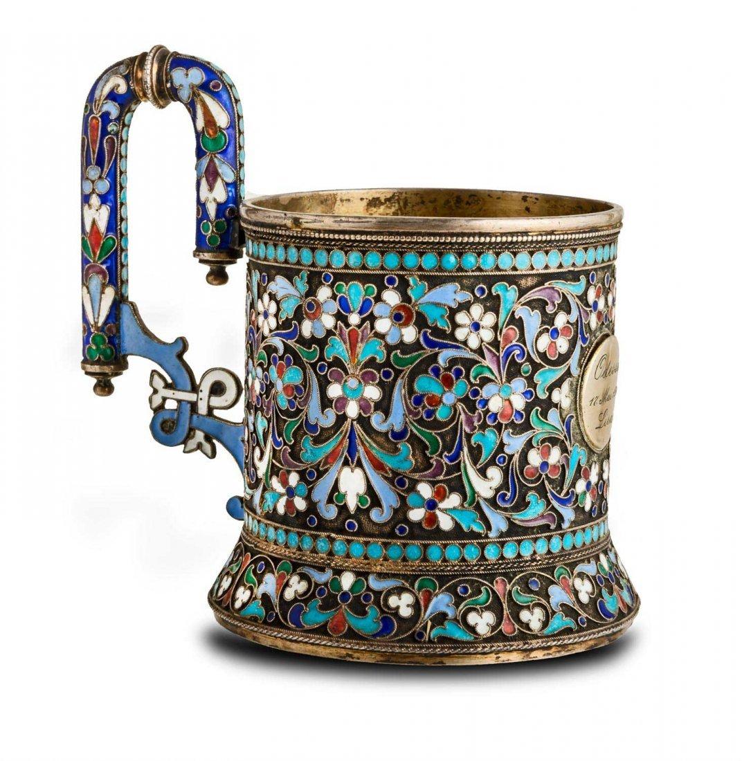 A Russian enamel and silver gilt tea glass holder,