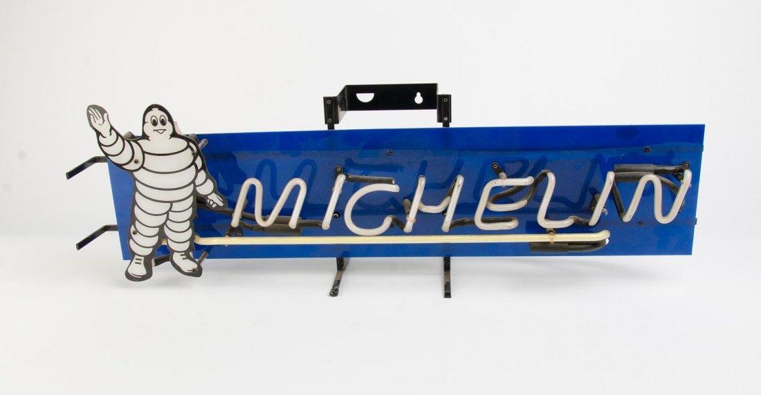 MICHELIN: A neon blue Michelin wall clock 38cm diameter