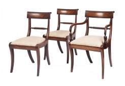 A set of nine Regency mahogany dining chairs comprising