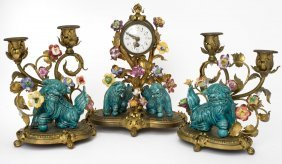 A French Serves Style Gilt Bronze Clock Garniture By A