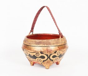 A Burmese Lacquer Black And Gilt Basket On Four Legs,