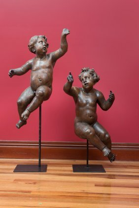 A Rare And Impressive Pair Of Carved Oak Cherubs,