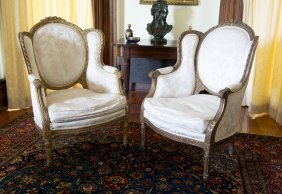 A Louis Xv Style Pair Of Carved Gilt Wood Fauteuils