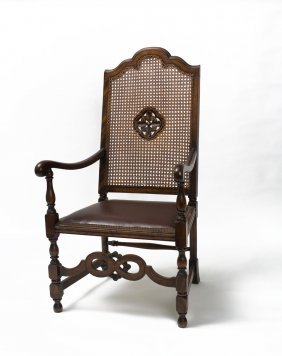 A Georgian Oak Armchair With Caned Back With Carved