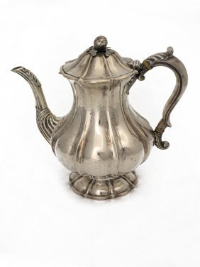 A George Iii Sterling Silver Fluted Coffee Pot By James