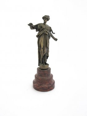 A Bronze Figure Of A Woman With A Yoke On Her Shoulder