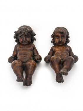 An Pair Of 18th Century Carved Walnut Figures Of Seated