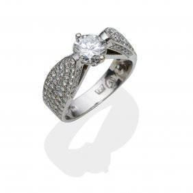 A 1.04 Carat Solitaire Diamond Ring, The Central Round