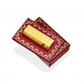 A Cigarette Lighter, Cartier. Gold Plated. Length 7cm.