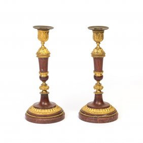 A Pair Of Rouge Marble And Gilt Bronze Candlesticks