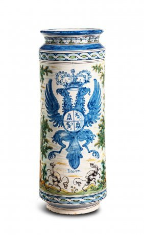 A Highly Decorative Armorial Design Majolica Stick And