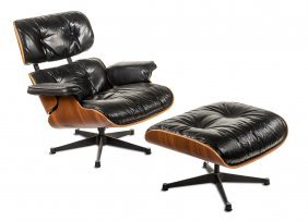 An Eames Tall Lounge Chair And Ottoman, Circa Late