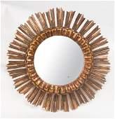 A gilt wood circular sunburst mirror Italian Circa