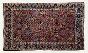 A fine Kashan part silk and wool rug with flower and