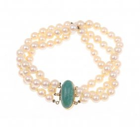 A Triple Strand Cultured Pearl Bracelet. The
