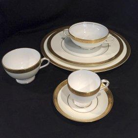 A Mintons Gilded Dinner Set, 20th Centurya Setting For